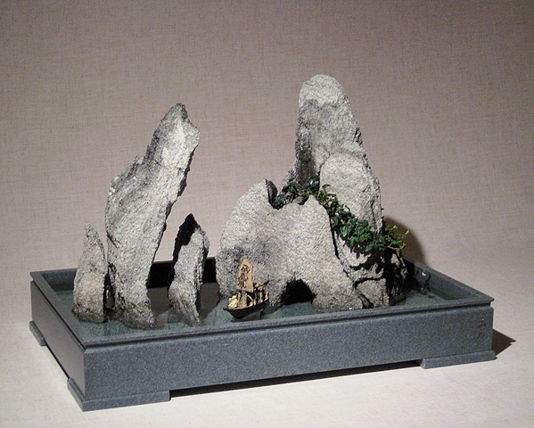 zen indoor fountain rock sculpture with ivy, fogger, and chinese figurines