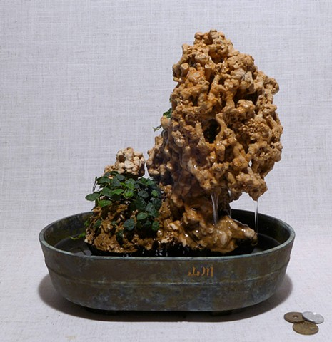 Tabletop fountain using extinct coral and live plants