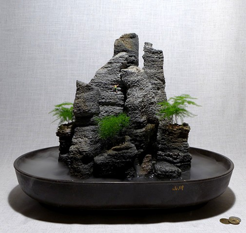 feather rock fountain with miniature climber, waterfall, fogger, and ferns