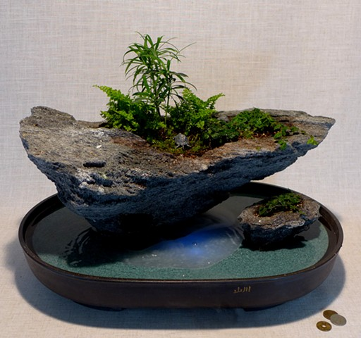 feather rock fountain with fogger, mixed plantings, miniatures, and waterfall