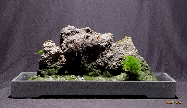 feather rock fountain in Corian tray, with miniature rock climber