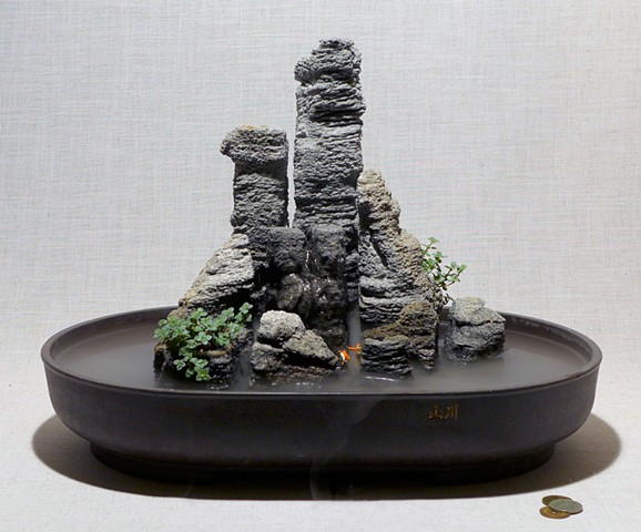 miniature sandstone park with fountain, fogger, miniature hikers, and pilea