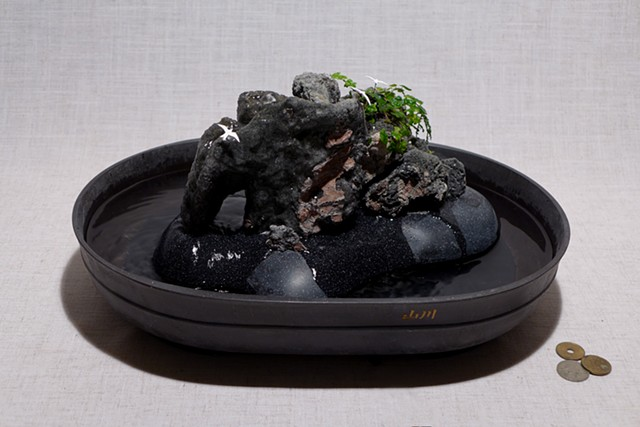 pyroclastic rock (feather rock) fountain with oakleaf fig and handmade birds