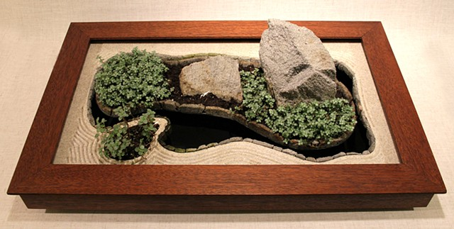 Zen pond garden with plants and rocks