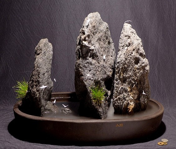 indoor fountain with fogger, bonsai grass, and miniature gullls