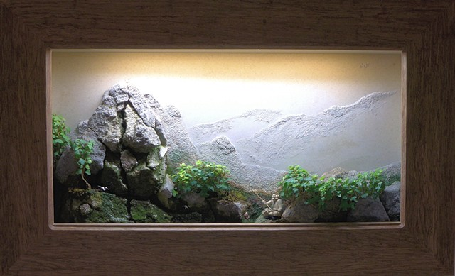 feather rock wall landscape with ivy, fountain, and miniatures