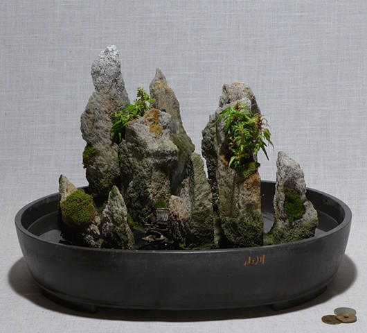feather rock fountain with live plants and ceramic miniatures