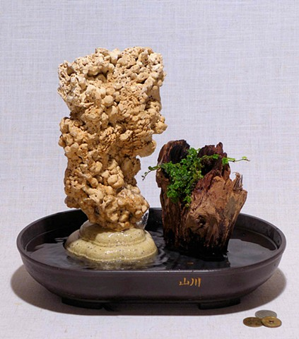 spaghetti rock fountain with Malaysian driftwood and oakleaf fig