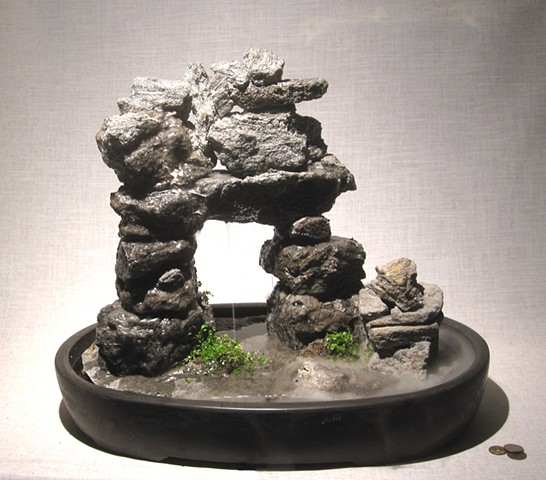 inuksuk feather rock fountain with fogger and plants