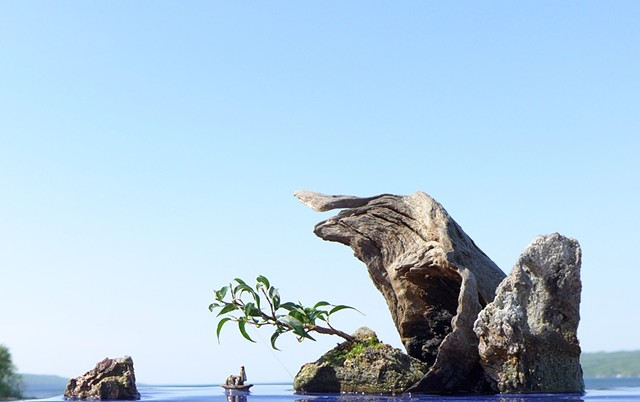 Corian suiban with driftwood, feather rock, fountain, and mudman boat