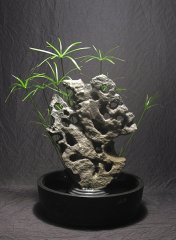 feather rock gonshi fountain with cyperus palm