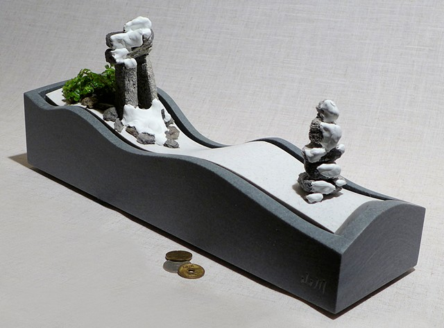 Corian tabletop fountain with inuksuit and pilea