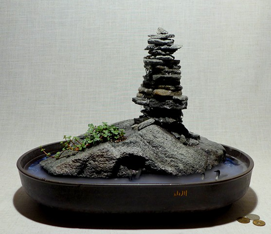 feather rock fountain with inuksuk, live plants, and handcarved bird miniatures