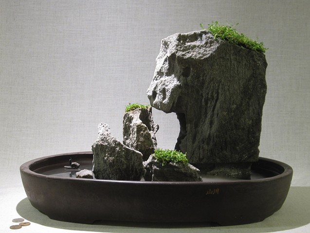 feather rock fountain with fogger, plants, and miniature boat