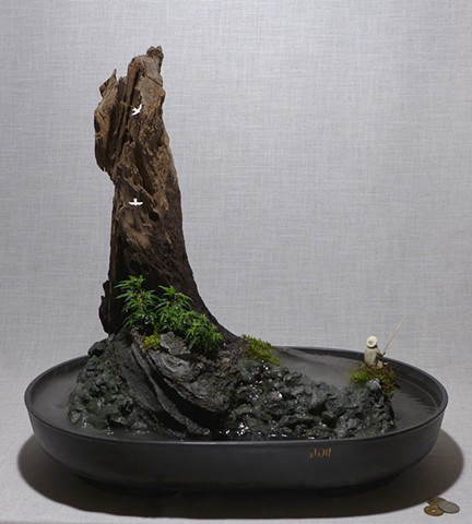 feather rock fountain with dwarf English ivy, fogger, and miniatures