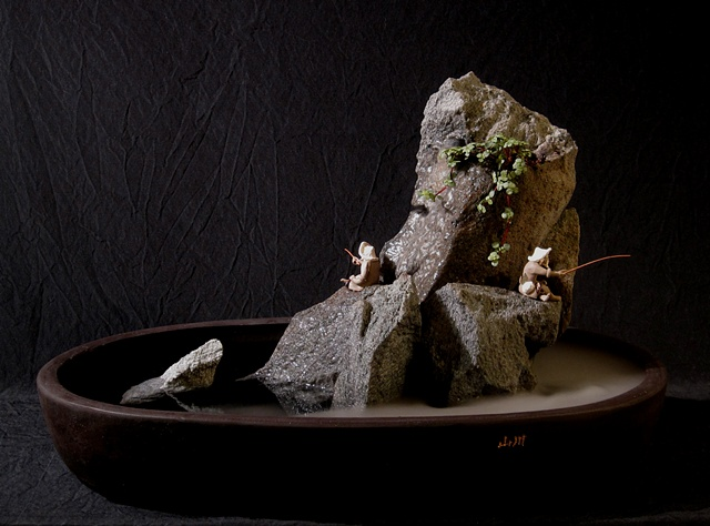 zen indoor fountain rock sculpture with ferns, fogger, and chinese figurines