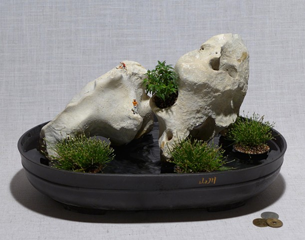Tabletop fountain of holey limestone with live plants and miniatures