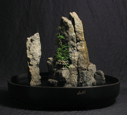 tabletop fountain with feather tock spires and temple miniature