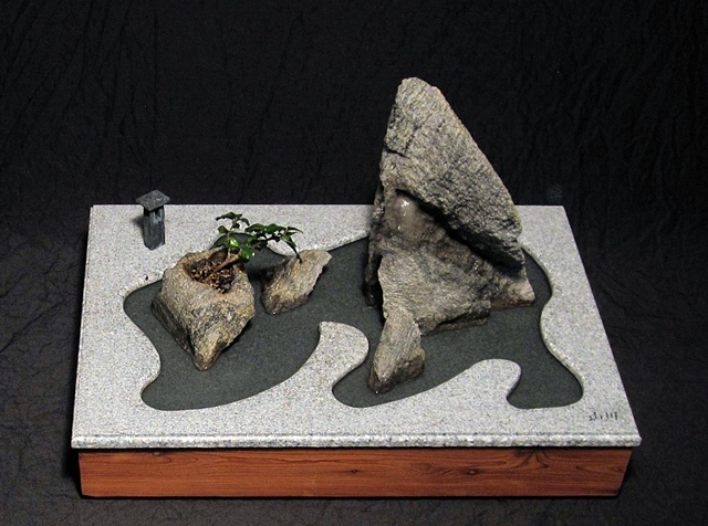 miniature japanese tea garden with fountain