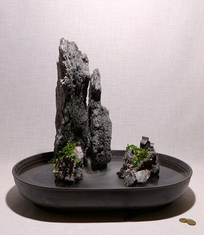 tall feather rock fountain with fogger, plants, and mudman figures