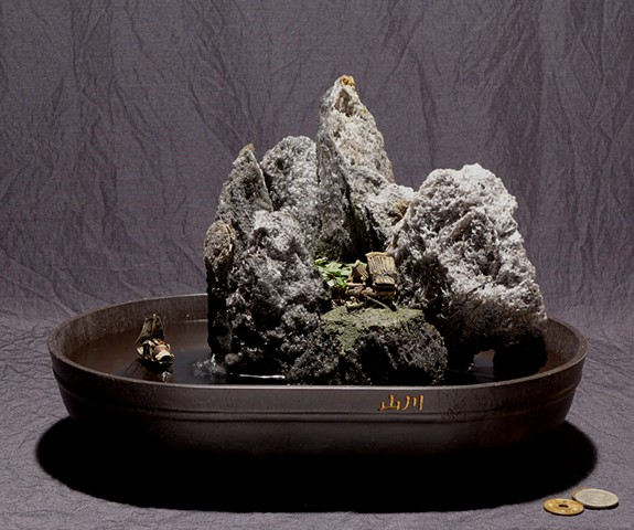 tabletop fountain with live plant and mudman miniatures