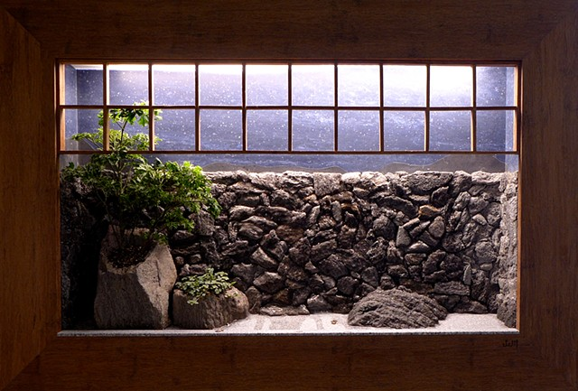 tsuboniwa wallscape with waterfall and plants