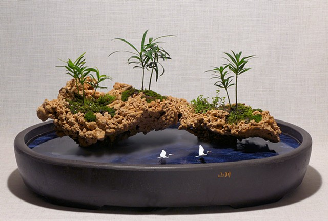 tabletop fountain with coral islands with live plants, fogger, and handmade bird figures