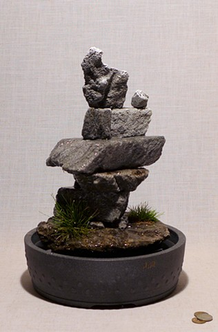 Inuit fountain sculpture with grasses