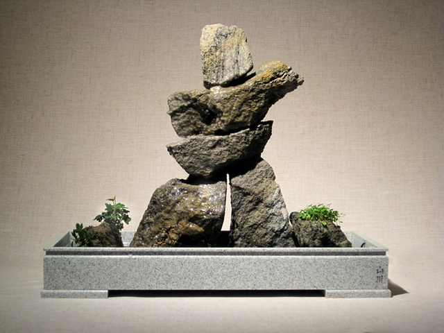 indoor inuksuk stone fountain with ivy