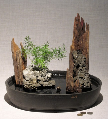 miniature seascape with waterfall, ming fern, and ceramic figurese