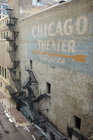 Original ghosted sign on the side of the Chicago heater building in downtown Chicago photographed by lucy mueller photography