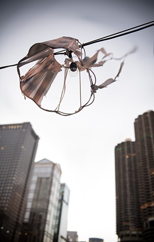 a tattered lampshade hangs above Chicago's skyline photographed by LucyMuellerPhotography