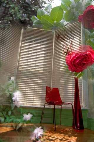Composite of a room with tall windows a red chair and roses in a garden by lucy mueller
