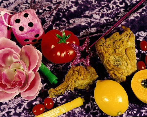"""Still Life with Pink Fuzzy Dice and Fried Chicken"""