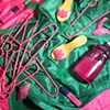 """Still Life with Pink Plastic Hangers (You make everything GROOVY.)"