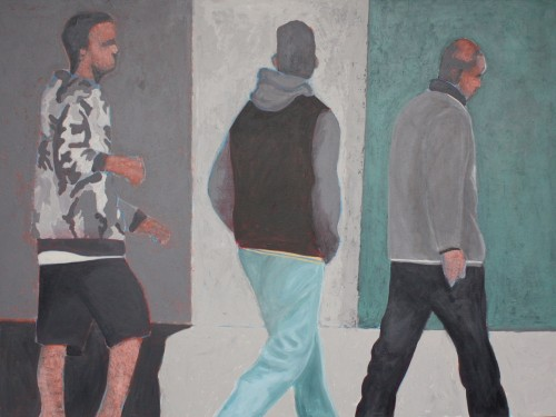 three men walking on street