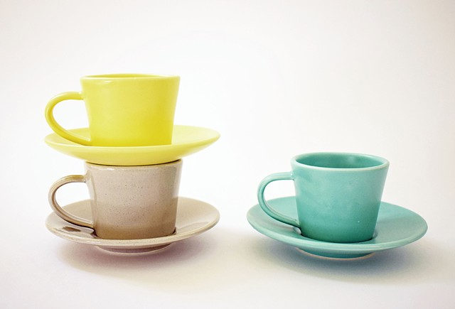 Espresso cups and saucers, carefully designed to stack neatly.