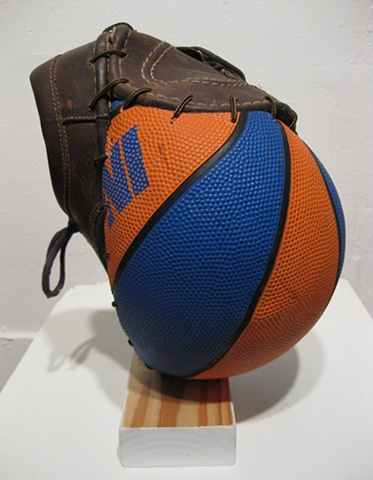 Title/Materials: Basketball, Artist's Shoes, Shoe Laces, Block of Wood, Paint