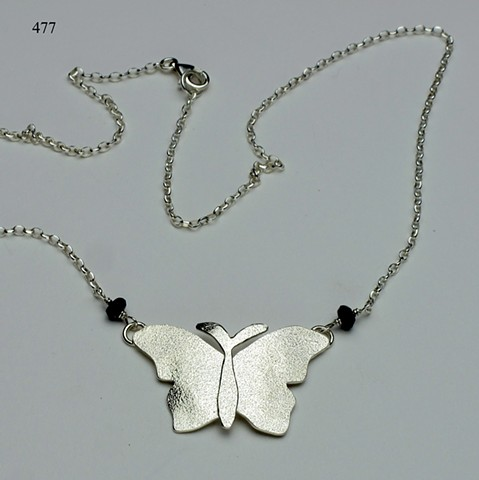 textured silver butterfly pendant on SS chain with lobster clasp, accented w/ iolite (#477)