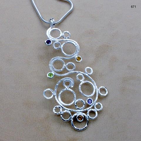 "s/s floating orb (31/2"") pendant w/ five 4mm bezel set gems (amethyst, peridot, citrine)  on 20"" s/s snake chain (#671)"