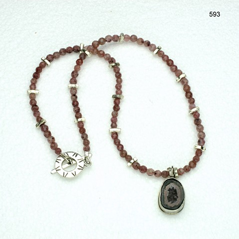 small geode set in silver pendant,on a strand of faceted pink muscovite, with silver accent beads and a silver toggle (#593)