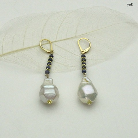 a baroque pearl hangs from faceted sapphires w/ vermeil Bali spacers on gold filled leverbacks (#721E)