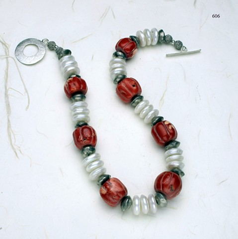 carved coral, Biwa disc pearls, Mali tribal silver beads, finished with a silver toggle (606)