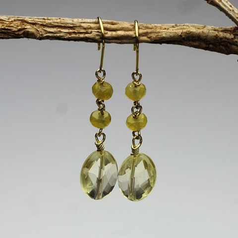 """delicate: a faceted citrine bead is suspended from 2 wire wrapped small faceted yellow opal rondels on an 18KT ear wire (! 1/2"""") (#309E)"""