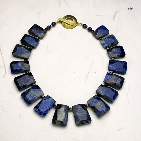 beautiful lapis collar of faceted stones accented with faceted pyrite and finished with a brass toggle (616)