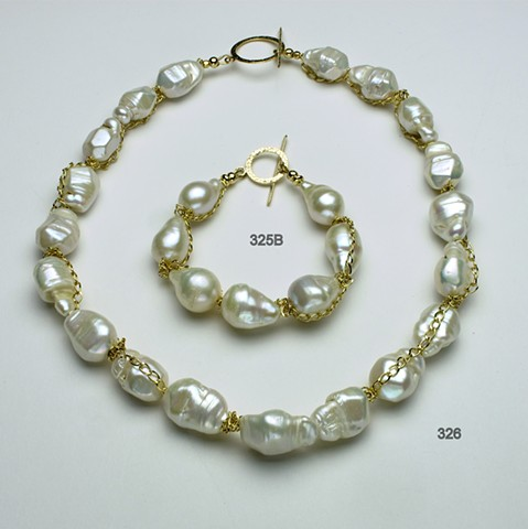 exquisite baroque pearls accented with gold filled chain and finished with a gold filled toggle (#326), coordinating bracelet (#325B)