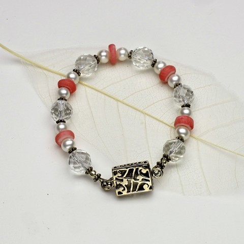 """coral rondels compliment the faceted quartz and pearls in this 7"""" bracelet, accented with Bali silver beads and finished with an open work sterling box clasp (#559B)"""