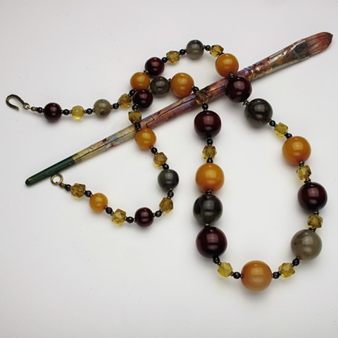 "36"" rope or tri-color resin, vintage crystal, garnet and brass beads, finished with a brass clasp. wear long or circle twice for a double strand statement (#916)"