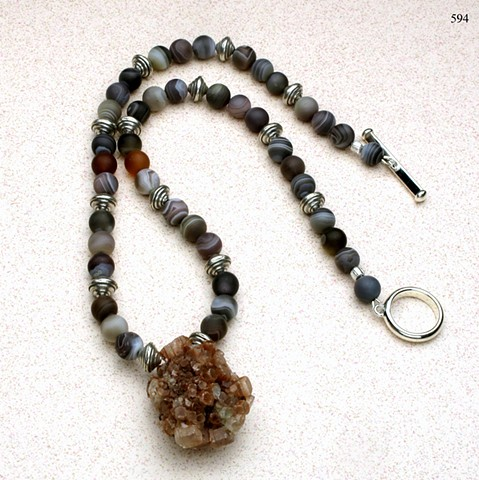 unusual argonite focal pendant accented with Botswanan agate, Hill Tribe silver beads and finished with a silver toggle (#594)