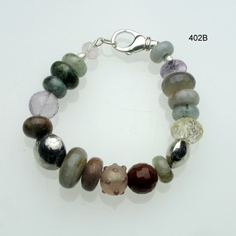 "earth-toned assorted semi precious beads w/ handcrafted silver beads, silver lobster clasp, 7"" (#402B)"